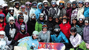 big happy group with snowboard